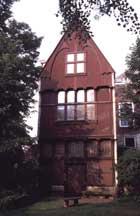 Afbeelding van het Malieniers pakhuis van den heer L.W. Agelink te Middelburg op den 17 van Loumaand 1816. Houten gevel aan de Lange Delft te Middelburg (Zelandia Illustrata deel II nr 716)